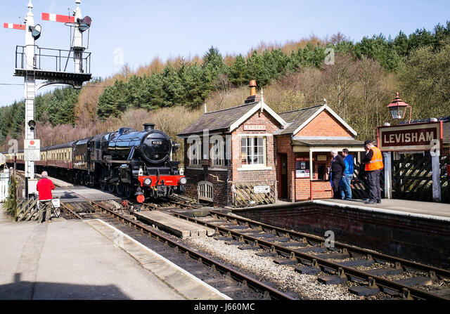 Steam locomotive 45212 arriving at Levisham station, North York Moors Railway, Yorkshire, UK - Stock Image