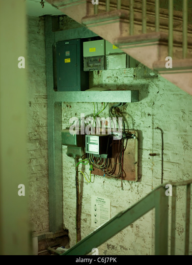 collection of fuse box and electricity meters in an old building c6j7pk fuse box stock photos & fuse box stock images alamy building regulations fuse box location at reclaimingppi.co