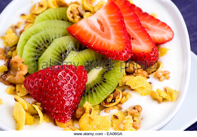 Fresh fruit, strawberries, kiwi, yogurt, nuts and granola. The granola ...