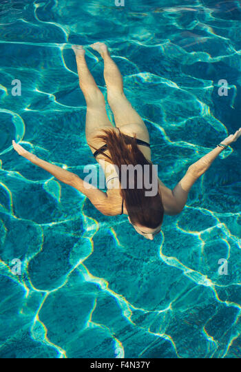 Pool travel underwater young stock photos pool travel for Pool koi goggles