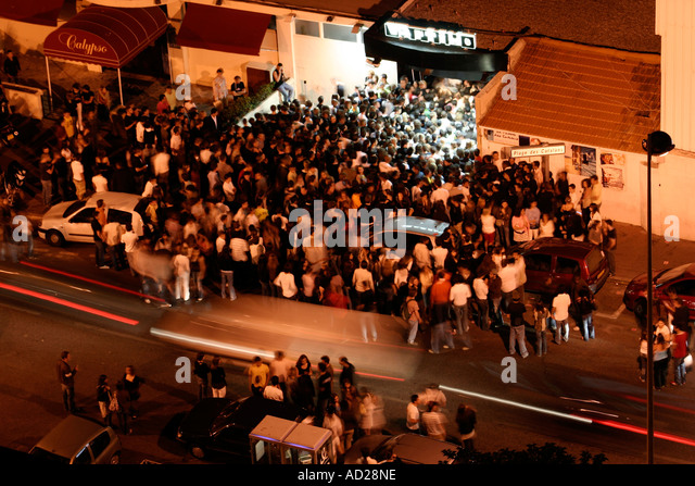 long-exposure-shot-of-a-large-crowd-forming-outside-a-disco-in-marseille-ad28ne.jpg