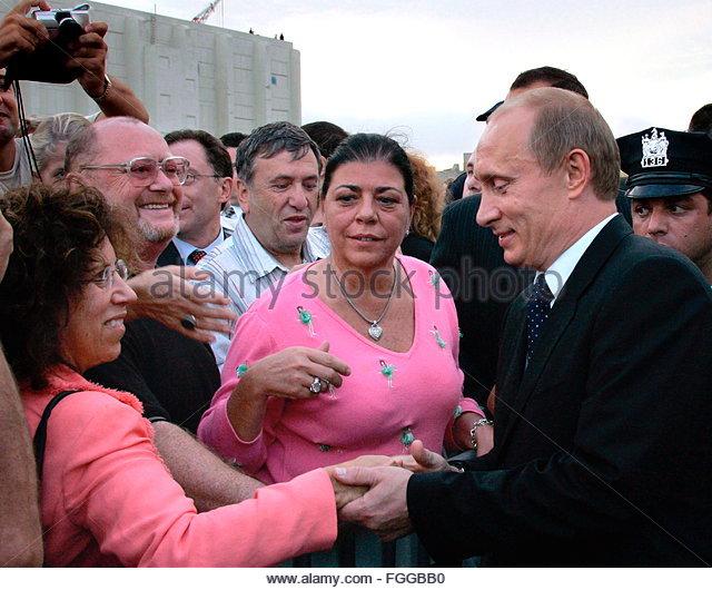 http://l7.alamy.com/zooms/ee58b1041493461eb868e6cfadfd1943/epa00530338-russian-president-vladimir-putin-r-shakes-hands-with-citizens-fggbb0.jpg