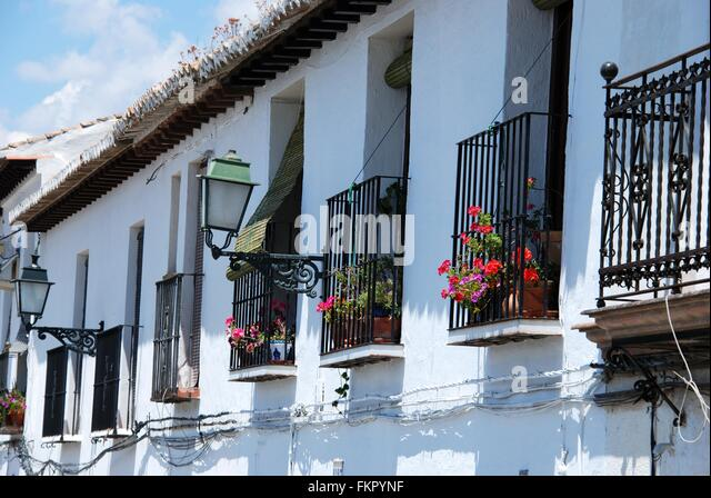 Whitewashed balcony flowers stock photos whitewashed for Balcony in spanish