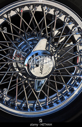wire spoked wheel on classic e type jaguar car after being refurbished stock image