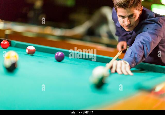 Man playing billiard stock photos man playing billiard for Pool man show