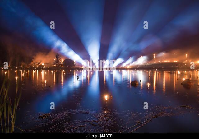 Light tubes from horizon - Leigo Lake Music Festival - Stock Image