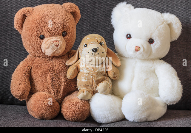 Cute Old Teddy Bears And Dog On Couch (three)   Stock Image