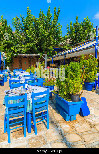 pythagorion port samos island sep 19 2015 blue chairs with tables in - Blue Restaurant 2015