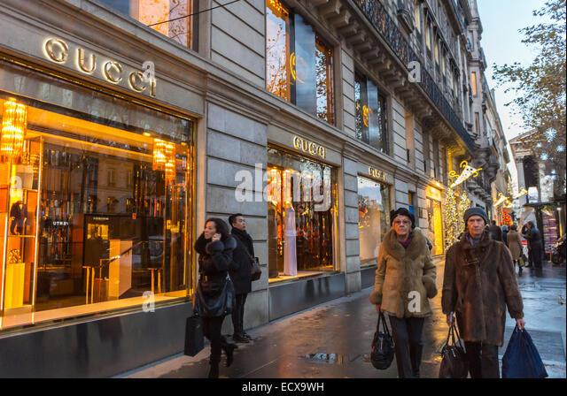 ... paris street people outside night luxury window shopping shops gucci 618c6652903