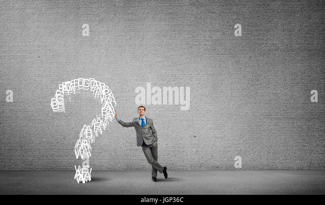 Man and big question mark - Stock Image