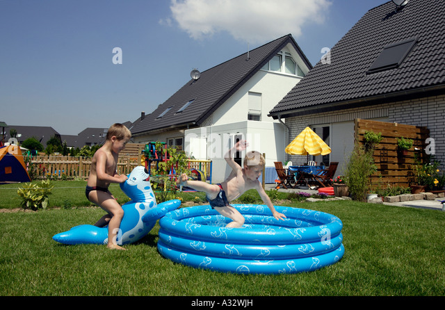 Paddling pool children splash stock photos paddling pool for Garden paddling pools