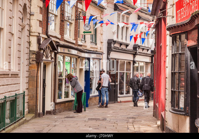 Shoppers and visitors in Grape Lane, Whitby, North Yorkshire, England. - Stock Image