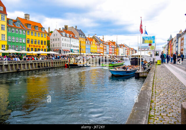 COPENHAGEN, DENMARK - JULY 20: Nyhavn, 17th century waterfront, canal and entertainment district and the popular - Stock Image