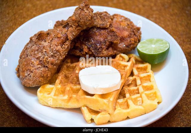 Habanero fried chicken and Waffles, Brunch at Momofuku Ma Peche Restaurant, Manhattan, New York - Stock Image