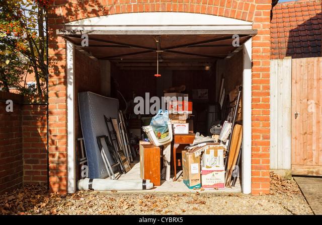 garage with door open used as storage uk stock image