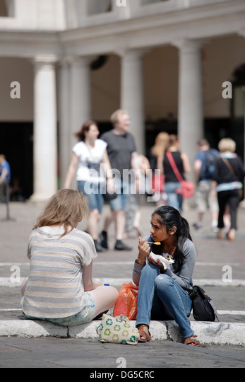 Marvellous Indian Eating Girls Stock Photos  Indian Eating Girls Stock  With Fair Two Young Women  One Caucasian Woman And One Asian Woman  Eating Lunch  Sitting On With Amazing Backyard Garden Ideas Also Solar Light For Garden In Addition Lechworth Garden City And Somerset Gardens Gp As Well As Covent Garden Uk Additionally Edgewater Gardens From Alamycom With   Fair Indian Eating Girls Stock Photos  Indian Eating Girls Stock  With Amazing Two Young Women  One Caucasian Woman And One Asian Woman  Eating Lunch  Sitting On And Marvellous Backyard Garden Ideas Also Solar Light For Garden In Addition Lechworth Garden City From Alamycom