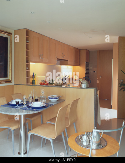 View Of A Dining Room Adjacent To Kitchen