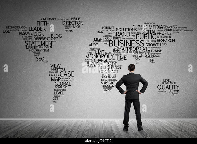 World map on concrete stock photos world map on concrete stock businessman standing with back and looking at world map on concrete wall stock image gumiabroncs Images