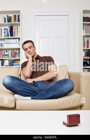 man staring at wedding ring