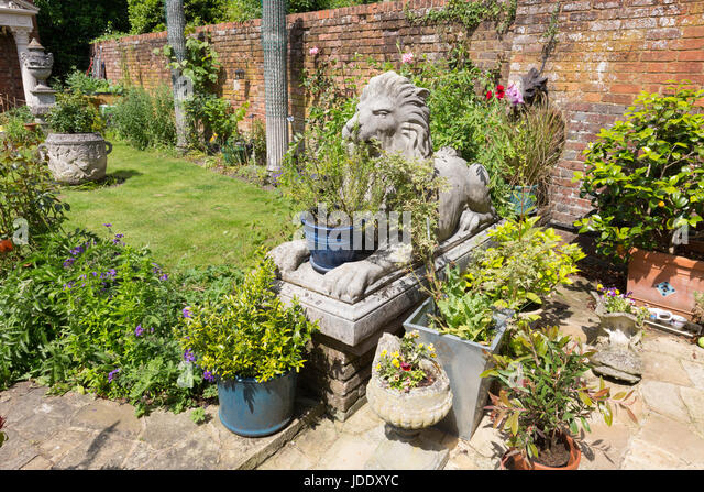 Delightful Large Garden Ornaments Including Lion Statues And Pots In An Ornate English  Garden, Kent England