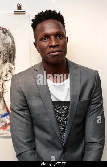 Guests attend Private View as African artist presents his collection of portraits set in urbanized landscapes  Featuring: - Stock Image