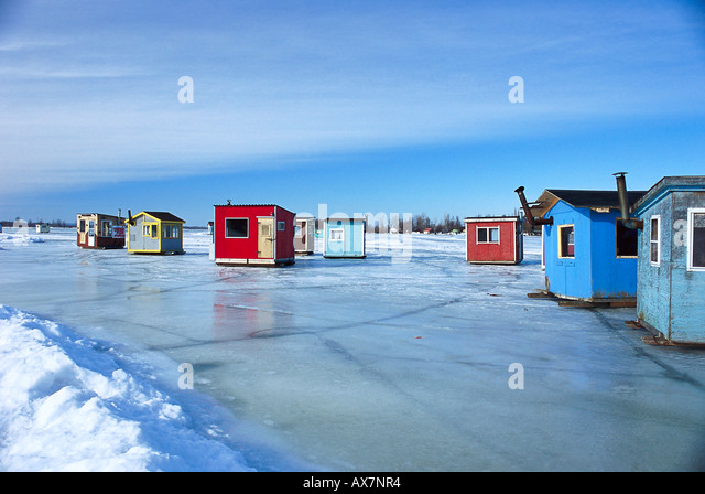 Standing water rural canada stock photos standing water for Ice fishing cabins alberta