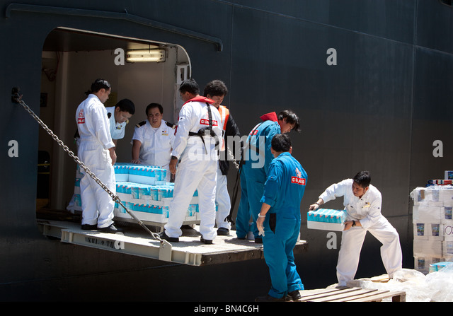 Workers Load Cruise Ship Supplies Stock Photos Workers Load - Cruise ship supplies