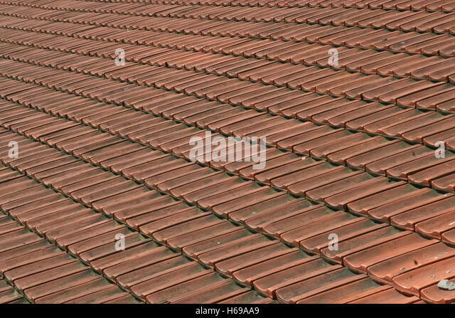 Red Ceramic Roof Tiles. Roof Tiles.   Stock Image