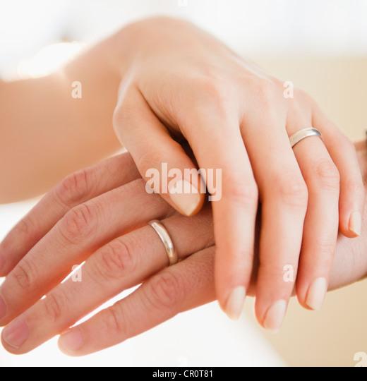 USA, New Jersey, Jersey City, Close Up Of Manu0027s And Womanu0027s Hands With