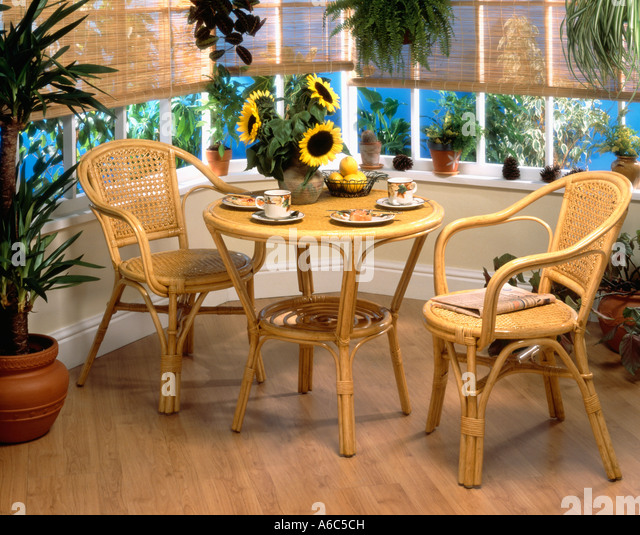 Cane Chairs And Table Set For Tea In Small Conservatory With Splitcane  Blinds   Stock Image