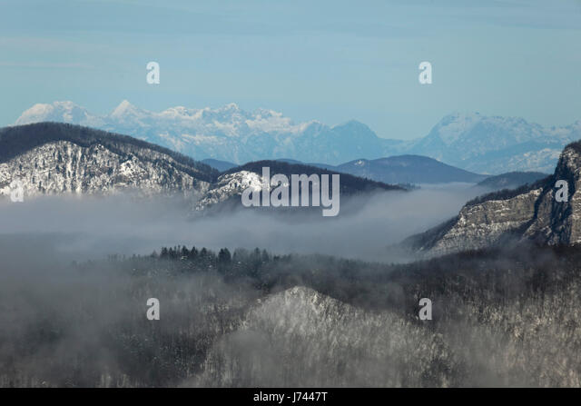 Winter morning with a mist in mountains of Croatia - Stock Image