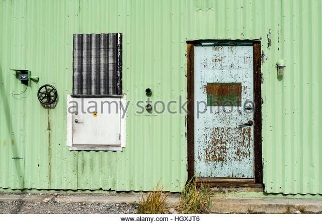 A Corrugated Tin Wall And Steel Door In An Old Factory. - Stock Image & Corrugated Steel Doors \u0026 Corrugated Sliding Door   Custom Sliding ...