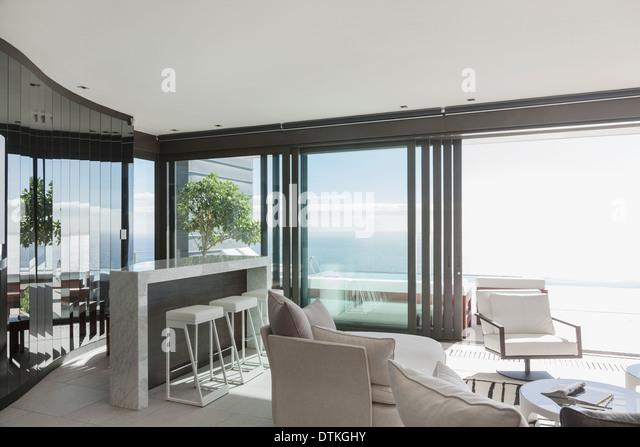 Narrow Breakfast Bar Overlooking Living Room