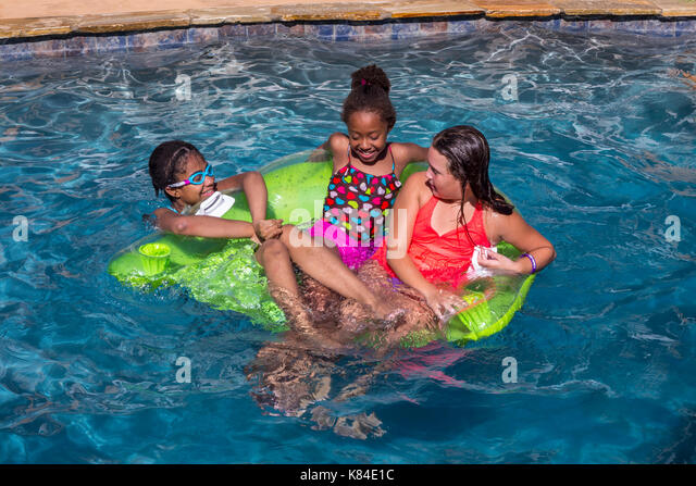 Multicultural teen girls stock photos multicultural teen girls stock images alamy for What is a freshwater swimming pool