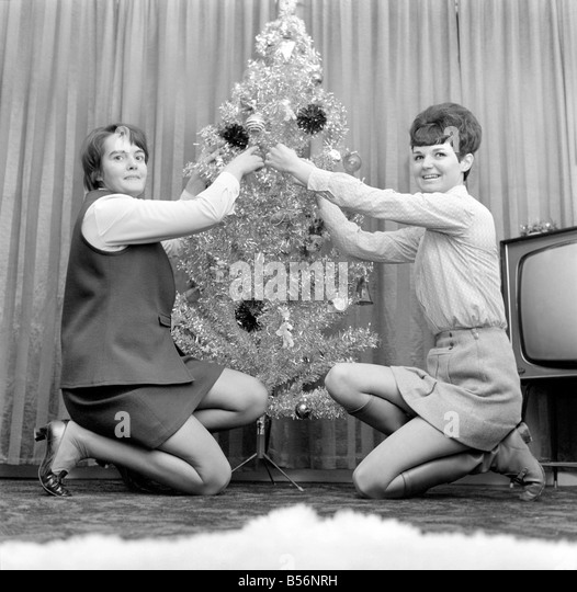 Black People Decorating For Christmas decorating christmas tree black and white stock photos & images