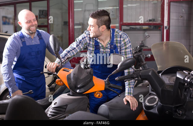 Shop assistant cycle stock photos shop assistant cycle for Motorized bicycle repair shop