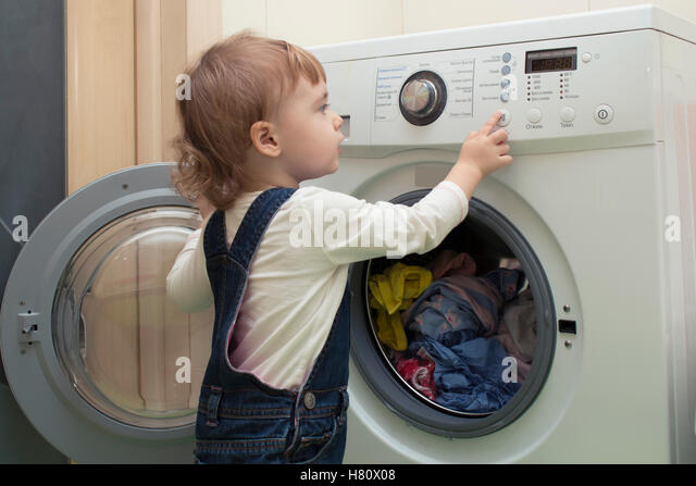 kid in washing machine