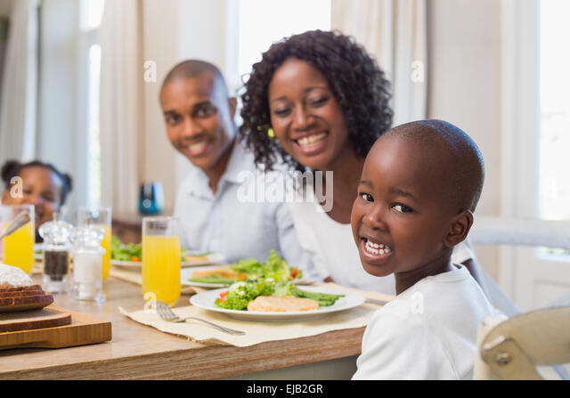 Happy Family Smiling At Camera Lunch