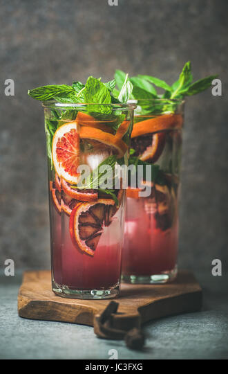 Blood orange citrus lemonade with mint and ice in glasses - Stock Image