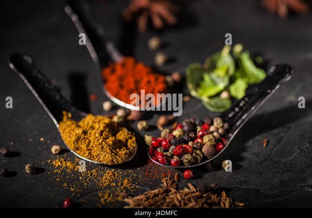 Spice selection on grey slate worktop - Stock Image