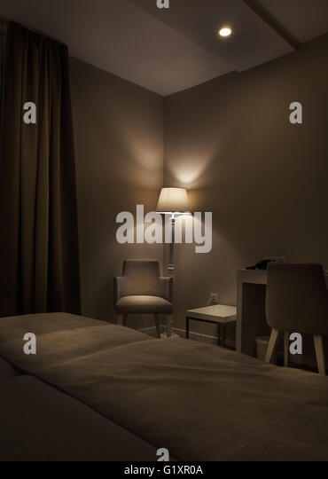 Details Of A Hotel Room Retro Lamp And Armchair Big Dark Brown Curtains