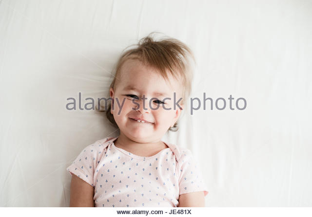 Friendly one year old baby smiling - Stock Image