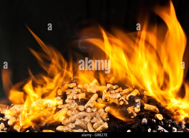 Burning Wood Biomass Pellets ~ Pellet stove stock photos images alamy