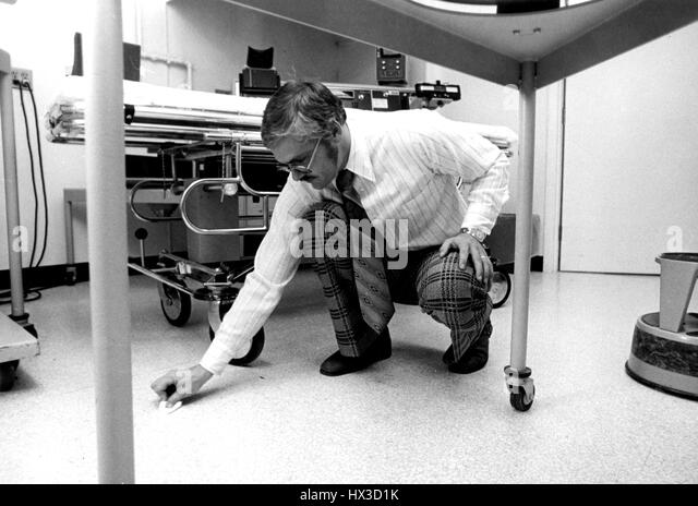 An Inspector For The Atomic Energy Commission Swabs The Floor Of A Licensed Hospital To Test