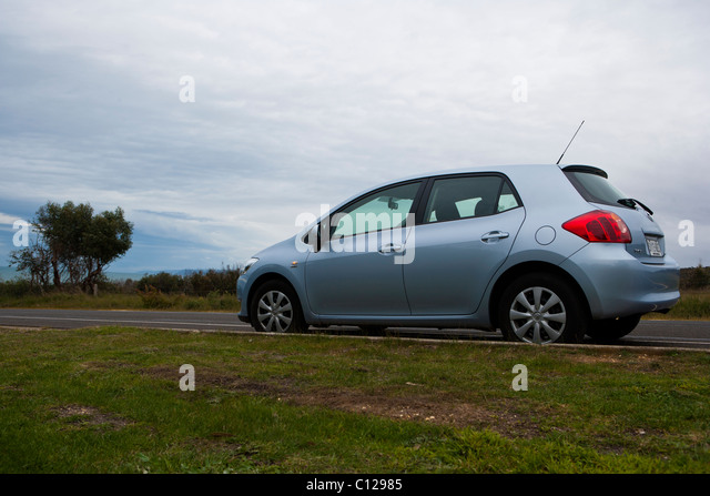 Toyota Corolla Ascent / Toyota Matrix Car Parked At Side Of Roadway.    Stock Image