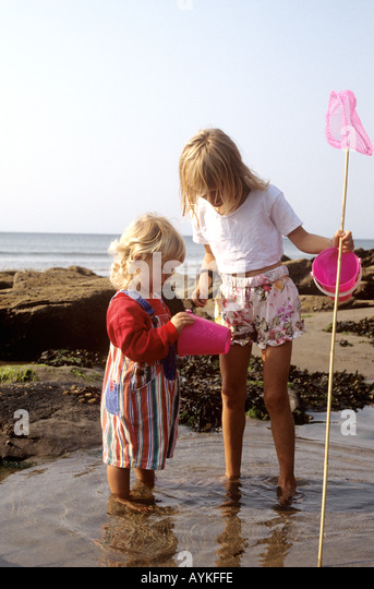 Toddler kids kid rockpooling stock photos toddler kids for Kids fishing net