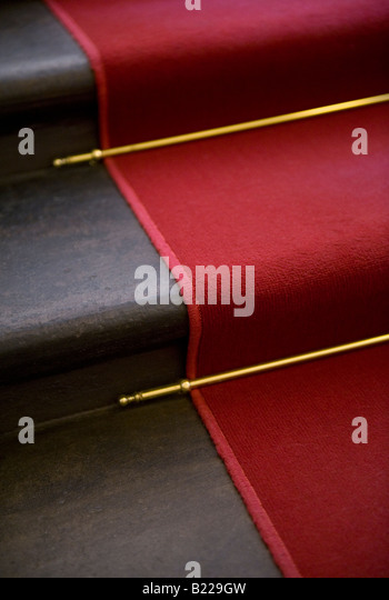 Red Carpet, Brass Stair Rods And Staircase   Stock Image