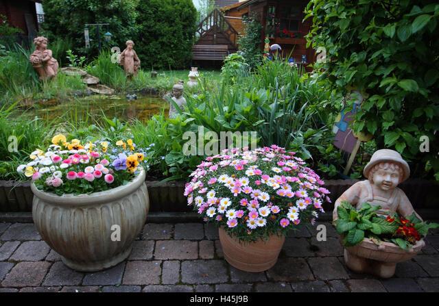 garden figures. Garden With Flowers And Figures, - Stock Image Figures