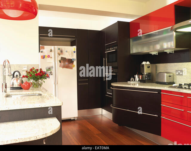 Black units stock photos black units stock images alamy for Red fitted kitchen
