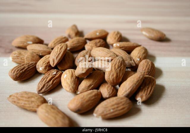 nuts oxidized snack almonds tonsils roasted parched salzmandeln knabberei salt - Stock Image